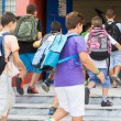 Students with their backpacks getting into school. First Day of  — Stock Photo #53933795