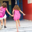 Students with their backpacks getting into school. First Day of — Stock Photo #53933839
