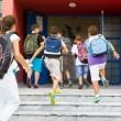 Students with their backpacks getting into school. First Day of — Stock Photo #53934001