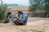 Car overturned with one dead from the flood in Liti near Thessa — Foto de Stock