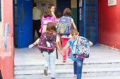 Students with their backpacks getting into school. First Day of  — Stock Photo