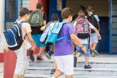 Students with their backpacks getting into school. First Day of  — ストック写真