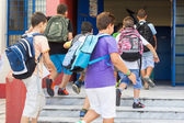 Students with their backpacks getting into school. First Day of  — Foto Stock