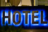 Beautiful hotel sign in Greece. Neon Sign with the word Hotel — Stock Photo