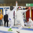 Постер, плакат: Young athletes competing during the World Youth Fencing Champion