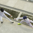 Young athletes competing during the World Youth Fencing Champion — Stock Photo #60778551
