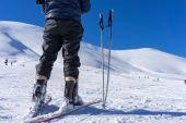 Ski poles near a skier on the mountain Falakro, in Greece. — Stock Photo
