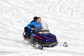 Visitors enjoy the snow on snowmobiles in Falakro ski center, Gr — Stock Photo