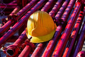 Yellow hardhat on construction site — Stock Photo