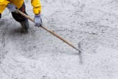 Pouring cement during sidewalk upgrade — Stock Photo