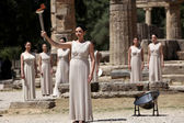 High Priestess, the Olympic flame during the Torch lighting cere — Stock Photo