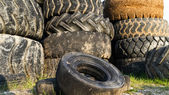 Numerous tires stacked on top of each other — Stock Photo