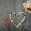 Colorful pills in the shape of the heart — Stock Photo #70947527