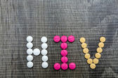 The word HIV(Human Immunodeficiency Virus) written whith pills o — Stock Photo