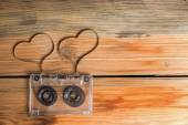 Vintage audio cassette with loose tape shaping two hearts on a w — Photo