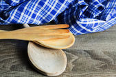 Wooden Kitchen Utensils on wooden background. Spoon,  fork and t — Stock Photo