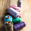 Spools of thread on wooden  background. Old sewing accessories. — Stock Photo #73330691