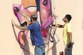 Painters graffiti during the course of Street Art Festival Thess — Stock Photo