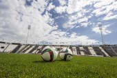 Balls of Paok team on the field of the stadium during team pract — ストック写真
