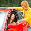 Mother with her daughter near red car — Stock Photo #56988231