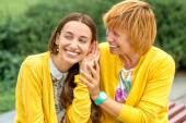 Portrait of mother with her daughter in the park — Stock Photo