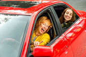 Mother with daughter in the red car — Stock Photo