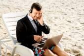 Businessman on the beach — Stock Photo