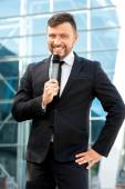 Portrait of well-dressed man on the contempopary background — Stock Photo