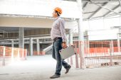 Foreman walking at the structure supervising. — Stock Photo