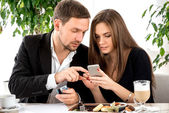 Young couple paying for ther order at the restaurant — Stock Photo