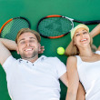 Young couple playing tennis — Stock Photo #57905757