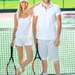 Young couple playing tennis — Stock Photo #57906719