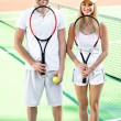 Young couple playing tennis — Stock Photo #57907781
