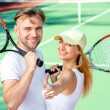 Young couple playing tennis — Stock Photo #57909139