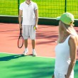 Young couple playing tennis — Stock Photo #57909853