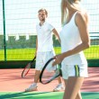 Young couple playing tennis — Stock Photo #57909879