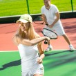 Young couple playing tennis — Stock Photo #57909953