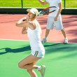 Young couple playing tennis — Stock Photo #57909995