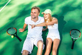 Young couple playing tennis — Stock Photo