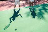 Players shadows on the tennis court — Stock Photo