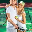 Young couple playing tennis — Stock Photo #57916349