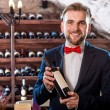 Sommelier in the wine cellar — Stock Photo #58199533