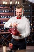 Sommelier in the wine cellar — Stock Photo