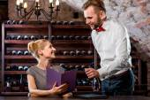 Sommelier with young woman on degustation in the cellar — Stock Photo