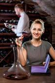 Woman tasting wine in the cellar — Stock Photo