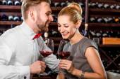 Couple having romantic wine tasting at the cellar — Stock Photo