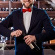 Sommelier in the wine cellar — Stock Photo #58220701