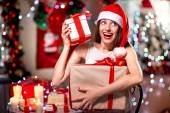 Young woman with present box on Christmas — Stock Photo