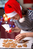 Woman making ginger cookies on Christmas — Stock Photo