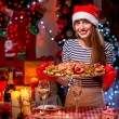 Woman preparing for Christmas dinner — Stock Photo #58853253